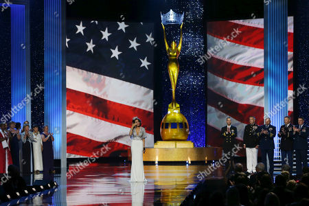 Stock Picture of Betty Cantrell The outgoing Miss America, Betty Cantrell, pauses and wipes a tear as she sings the National Anthem during the Miss America 2017 pageant, in Atlantic City, N.J