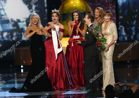 Stock Photo of Betty Cantrell, Savvy Shields The outgoing Miss America, Betty Cantrell,second left, reacts as she tries to put a Miss America sash on winner Miss Arkansas Savvy Shields during the Miss America 2017 pageant, in Atlantic City, N.J