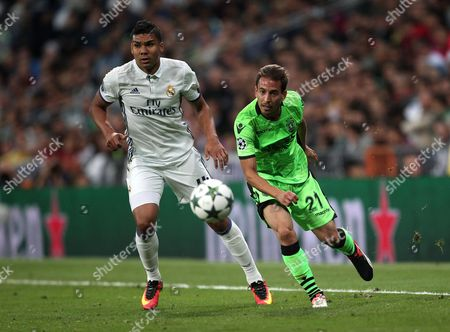 Joao Pereira of Sporting Lisbon and  Casemiro of Real Madrid  during the  UEFA Champions League , Group F match between Real Madrid and Sporting Lisbon played at Santiago  Bernabeu stadium   ,Madrid  on 14th September  2016