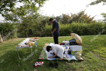 Stock Image of North Korean refugee Jang Yun-nam and his wife Nam Sun-hee pray for their ancestors in North Korea to celebrate the Chuseok, the Korean version of Thanksgiving Day, at the Imjingak Pavilion, near the demilitarized zone of Panmunjom, in Paju, South Korea, . The annual homeward exodus of Korean people for the Chuseok holidays began Wednesday, with about 30 million people expected to join the throngs of travelers this year nationwide