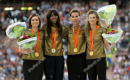 Belgian runners Kim Gevaert, Elodie Ouedraogo, Olivia Borlee and Hanna Marien stand on the podium after receiving the gold medal for the Women's 4 x 100 meters relay at the 2008 Beijing Olympics during the Diamond League Memorial Van Damme athletics event, at the King Baudouin stadium in Brussels on . The Belgian team, initially winning silver, were moved up to gold after one runner on the Russian team tested positive for a banned substance
