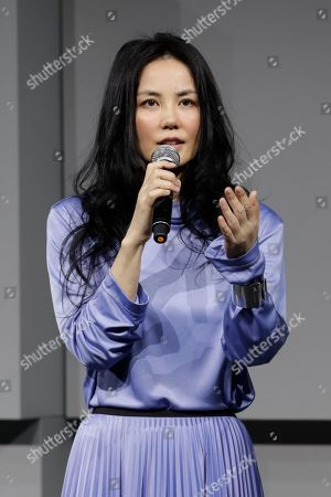 """Chinese pop singer Faye Wong speaks during a press conference in Beijing, . Wong is in Beijing to launch her """"Faye's Moment"""" concert which will held at the Mercedes-Benz Arena in Shanghai, China on Dec. 30, 2016"""