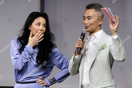 """Stock Photo of Chinese pop singer Faye Wong, left, looks at the host during a press conference in Beijing, . Wong is in Beijing to launch her """"Faye's Moment"""" concert which will held at the Mercedes-Benz Arena in Shanghai, China on Dec. 30, 2016"""
