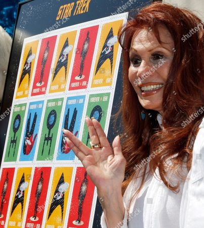 """Stock Image of BarBara Luna Her preverred spelling BarBara Luna, right, who had a role as Lt. Marlena Moreau in an episode of the television series, gives the 'Live Long And Prosper' salute during ceremonies to introduce the new series of commemorative stamps based on the """"Star Trek"""" television series and movies, on the 50th anniversary of its broadcast debut, in the Hollywood district of Los Angeles . The series made its TV debut on Sept. 8, 1966, and ran for three seasons. The stamp was officially unveiled Sept. 2 in New York"""