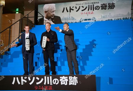 """Tom Hanks, Aaron Eckhart, Ebizo Ichikawa Tom Hanks, center, Aaron Eckhart, left, and Japanese traditional kabuki actor Ebizo Ichikawa pose for photographers during the Japan premiere of """"Sully"""" in Tokyo, . Japanese letters, top and bottom, read """"Miracle on the Hudson"""