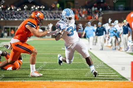 North Carolina running back Elijah Hood (34) reaches the end zone past Illinois defensive back Taylor Barton (3) during the second half of an NCAA college football game at Memorial Stadium in Champaign, Ill