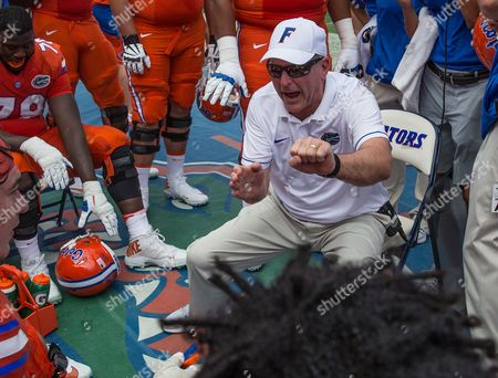 Stock Image of Florida Offensive Line Coach Mike Summers instructs his players during 1st half NCAA football action against Kentucky at University of Florida