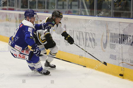Scott Macaulay of Stavanger Oilers in action v Eirik Børresen of Sparta during the Terminliste Get-Ligean match between Stavenger Oilers and Sparta at DNB Arena, Stavanger