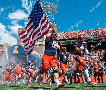 Matt Long Illinois players take the field as Illinois offensive lineman Matt Long (68) carries the flag before an NCAA college football game against Murray State, at Memorial Stadium in Champaign, Ill. Illinois defeated Murray St. 52-3
