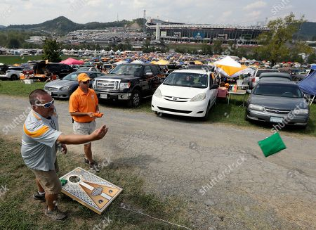 Robert Wagner, Cary Conegan Robert Wagner, left, and Cary Donegan play a bean bag toss game as they tailgate outside Bristol Motor Speedway before an NCAA college football game between Tennessee and Virginia Tech, in Bristol, Tenn