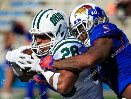 Dorian Brown, Marcquis Roberts Ohio running back Dorian Brown (28) is tackled by Kansas linebacker Marcquis Roberts (5) during the second half of an NCAA college football game in Lawrence, Kan., . Ohio defeated Kansas 37-21