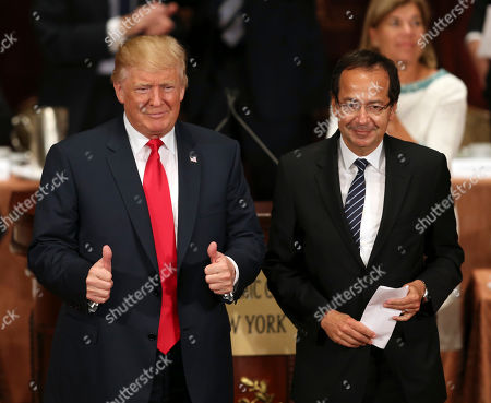 Donald Trump, John Paulson Republican presidential candidate Donald Trump gives the thumbs up while standing with John Paulson at a luncheon for the Economic Club of New York in New York