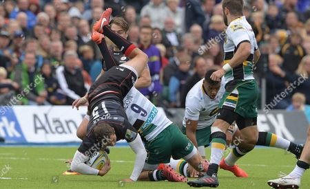 Saracens' Alex Goode is lifted in a tackle by Northampton's Lee Dickson (9)