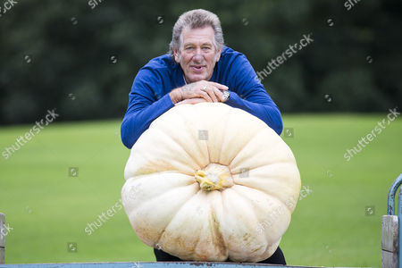 Brian Marshall & his prize winning Pumpkin that weighed 139.5 KG at the Giant vegetable competition in Harrogate.