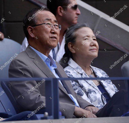 United Nations Secretary General Ban Ki-moon, left, and his wife, Yoo Soon-taek watch play between Stan Wawrinka, of Switzerland, and Novak Djokovic, of Serbia, during the men's singles final of the U.S. Open tennis tournament, in New York