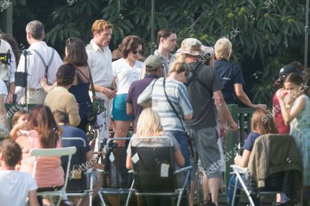 Stock Image of James Norton and actress Seline Hizli, (blue shorts) filming the new series of the ITV drama Grantchester