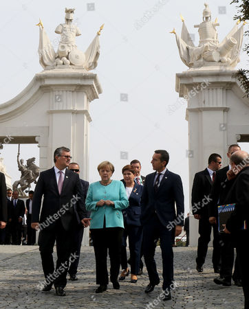 Tihomir Oreskovic, Angela Merkel, Christian Kern Prime Minister of Croatia Tihomir Oreskovic, German Chancellor Angela Merkel and Austrian Chancellor Christian Kern, from left, arrive for a group photo at an EU summit in front of Bratislava Castle in Bratislava, Slovakia, . An EU summit, without the participation of the United Kingdom, in Bratislava will kick off the discussion on the future of EU following Brexit