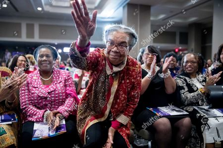 Sheila Jackson Lee, Marian Wright Edelman Children's Defense Fund President and founder Marian Wright Edelman, center, accompanied by Rep. Sheila Jackson Lee, D-Texas, left, waves as she is acknowledged by Democratic presidential candidate Hillary Clinton during Clinton's address at the Black Women's Agenda's 29th Annual Symposium, in Washington