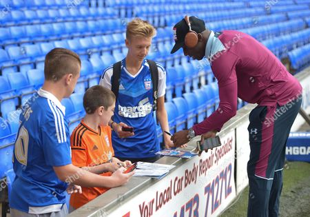 Aly Cissokho of Aston Villa signs autographs for fans during the Sky Bet Championship match between Ipswich Town and Aston Villa played at Portman Road, Ipswich on 17th September 2016