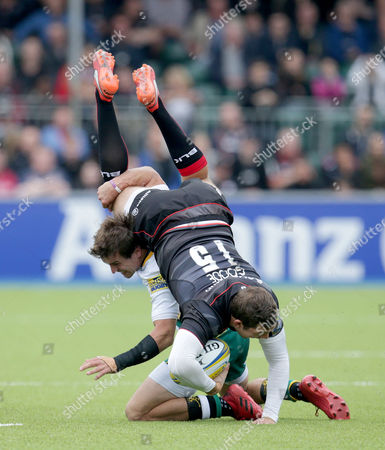 Alex Goode of Saracens is up ended by Lee Dickson of Northampton