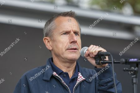 Comedian Jeremy Hardy introduces speakers on stage