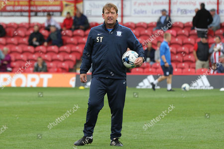 Preston North End First Team Coach, Steve Thompson, closely watches the players in the pre-match warm up during Brentford vs Preston North End, Sky Bet EFL Championship Football at Griffin Park on 17th September 2016