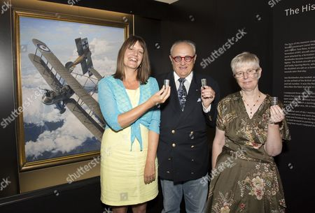 Baron Donat von Richthofen, great-nephew of Manfred von Richthofen, the Red Baron,  Jill  Bush  (wearing blue & yellow), cousin of 2 nd Lieut. Lionel Morris  (former Whitgift pupil)  and Meriel Jones  (wearing floral dress),  great-niece  of Capt. Tom Rees,  drinking toast together  among displays of original artefacts linked to their relatives.