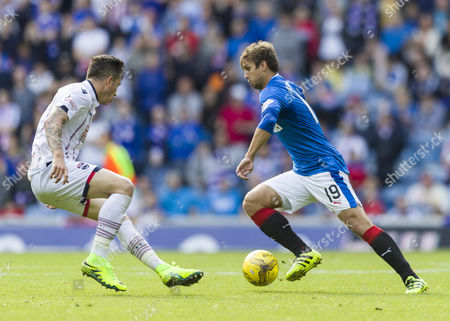 Niko Kranjcar of Rangers runs at Christopher Routis of Ross County during the SPFL Ladbrokes Premiership match between Rangers and Ross County at Ibrox Stadium, Glasgow on 17th September