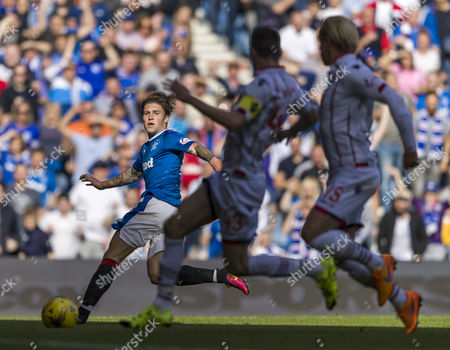 Josh Windass of Rangers shoots after going round Ross County goalkeeper Scott Fox but his shot was cleared by Paul Quinn of Ross County during the SPFL Ladbrokes Premiership match between Rangers and Ross County at Ibrox Stadium, Glasgow on 17th September