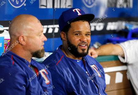 Justin Mashore, Prince Fielder Texas Rangers assistant hitting coach Justin Mashorea, left, talks with Prince Fielder, right, during a baseball game against the Oakland Athletics, in Arlington, Texas