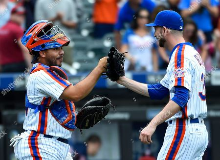 Rene Rivera, Jerry Blevins New York Mets catcher Rene Rivera congratulates relief pitcher Jerry Blevins after the Mets defeated the Minnesota Twins 3-2 in a baseball game, in New York