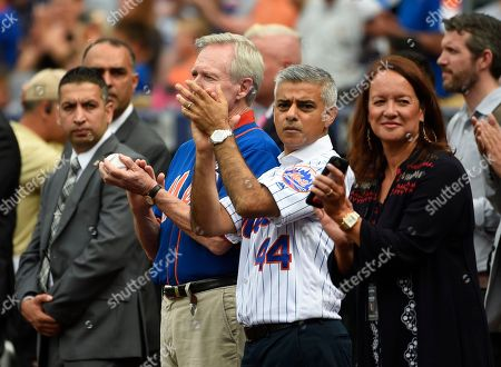 Sadiq Khan, Ray Mabus The mayor of London, England Sadiq Khan, second from right and Ray Mabus, Secretary of the U.S. Navy, second from left, applaud after the singing of the National Anthem before a baseball game between the New York Mets and the Minnesota Twins, in New York. Both Mabus and Sadiq threw out first ceremonial pitches