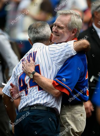 Sadiq Khan, Ray Mabus The mayor of London, England Sadiq Khan, left, hugs Ray Mabus, Secretary of the U.S. Navy, after Mabus threw out a first ceremonial pitch before the baseball game between the New York Mets and the Minnesota Twins, in New York. Both Mabus and Sadiq threw out ceremonial pitches