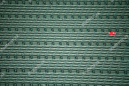 The red seat marking the distance of a Ted Williams home run is seen in the bleachers at Fenway Park before a baseball game between the Boston Red Sox and the New York Yankees in Boston