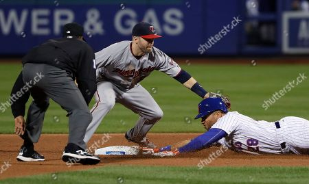 New York Mets' James Loney (28) slides safely into second base ahead of the tag from Minnesota Twins second baseman Brian Dozier during the sixth inning of a baseball game, in New York. Loney stretched a hit to right field into a double