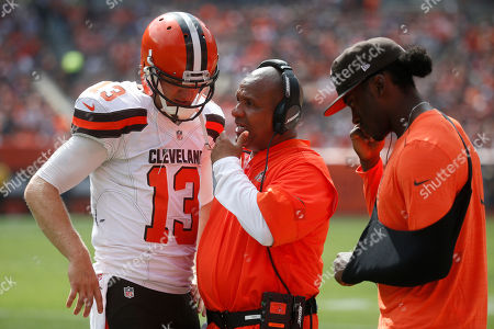 Hue Jackson, Josh McCown, Robert Griffin III Cleveland Browns head coach Hue Jackson, center, meets with quarterback Josh McCown (13) and quarterback Robert Griffin III, right, on the sidelines in the first half of an NFL football game against the Baltimore Ravens, in Cleveland