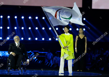 Yuriko Koike, Philip Craven Governor of Tokyo Yuriko Koike, right, waves the Paralympic flag next to the International Paralympic Committee President Sir Philip Craven during the closing ceremony of the Rio 2016 Paralympic Games at Maracana Stadium in Rio de Janeiro, Brazil