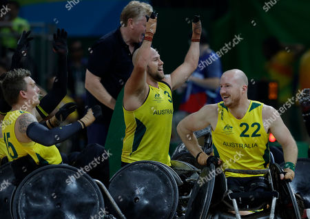 Ryley Batt, Matt Lewis, Andrew Harrison Australia's Ryley Batt, center, celebrates with his teammates Matt Lewis, right, and Andrew Harrison at the end of the mixed wheelchair soccer final match with United States at the Paralympic Games in Rio de Janeiro, Brazil, . Australia won the gold medal