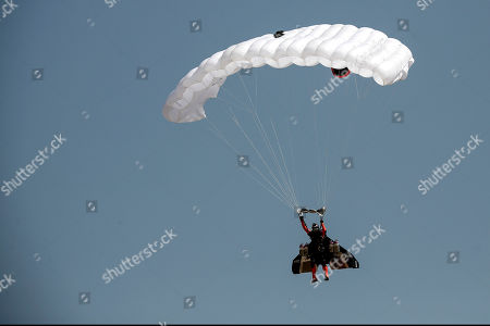 Vince Reffet, a team member of Swiss pilot Yves Rossy, known as Jetman, opens his parachute during a performance at Tanagra air base, north of Athens, on . The performance is part of an annual airshow, known as Athens Flying Week, which hosts aerobatic teams from several countries