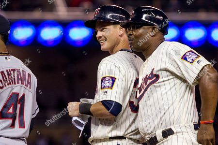 James Beresford, Butch Davis Minnesota Twins James Beresford celebrates with first base coach Butch Davis his first major league hit against the Cleveland Indians in the seventh inning of a baseball game, in Minneapolis. The Twins won 2-1 in 12 innings