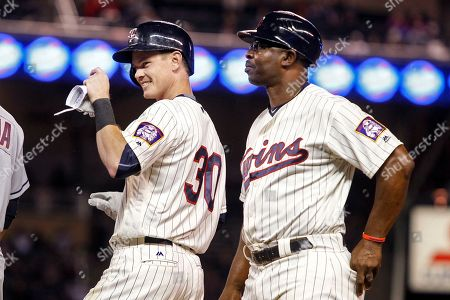 James Beresford, Butch Davis Minnesota Twins James Beresford celebrates with first base coach Butch Davis after his first major league hit against the Cleveland Indians in the seventh inning of a baseball game, in Minneapolis. The Twins won 2-1 in 12 innings