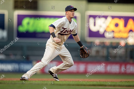 James Beresford Minnesota Twins third baseman James Beresford fields a ball hit by the Cleveland Indians in his major league debut at a baseball game, in Minneapolis