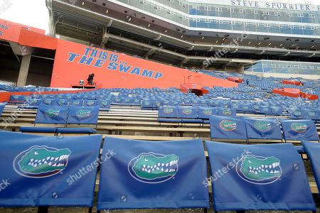 Florida Gator seat backs sit in the stands of Ben Hill Griffin Stadium before an NCAA college football game against North Texas in Gainesville, Fla