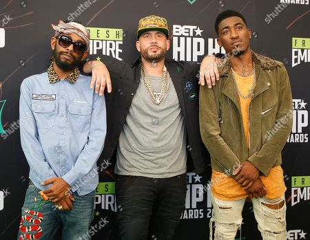 Skeme, DJ Drama, Lyquin Skeme, left-right, DJ Drama, and Lyquin on the green carpet for the BET Hip Hop Awards in Atlanta