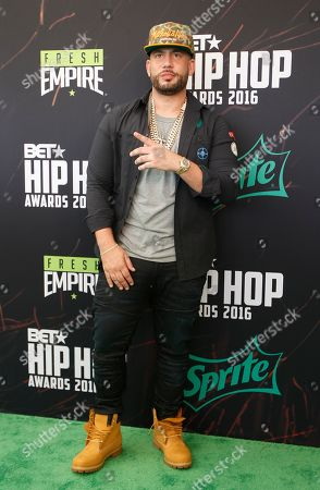 DJ Drama Hip-hop DJ Drama poses for photographers as he arrives for the BET Hip Hop Awards in Atlanta
