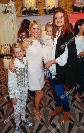 Mariya Dykalo and Natasha Rufus Isaacs with children