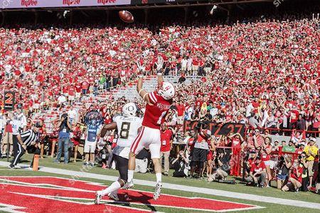 Nebraska Cornhuskers wide receiver Jordan Westerkamp #1 leaps and makes a touchdown catch over Oregon Ducks defensive back Reggie Daniels #8 in 2nd quarter action