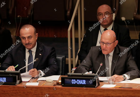 Mevlut Cavusoglu, Foreign Minister for Turkey, left, and Tammam Salam, right, Prime Minister of Lebanon, lead a meeting addressing actions and cooperation on the large movement of refugees and migrants, at U.N. headquarters