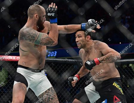 Fabricio Werdum, Travis Browne Fabricio Werdum, right, from Brazil, charges toward Travis Browne during a heavyweight bout at UFC 203, in Cleveland