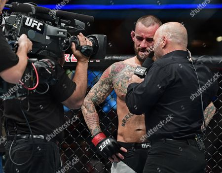 CM Punk, Joe Rogan CM Punk, left, is interviewed by Joe Rogan after being defeated by Mickey Gall in a welterweight bout at UFC 203, in Cleveland